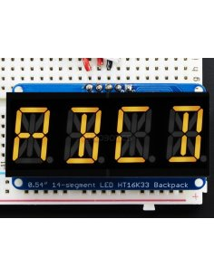 "Quad Alphanumeric Display - Yellow 0.54"" Digits with I2C Backpack"